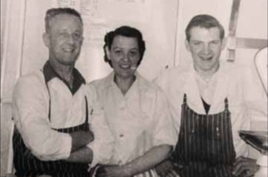 Former owners Eric and Jean Flett, with Ally Park  - pictured in the butcher shop in the early 1960s